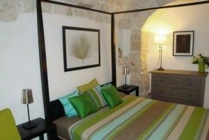 A bedroom in masseria Settarte in Cisternino