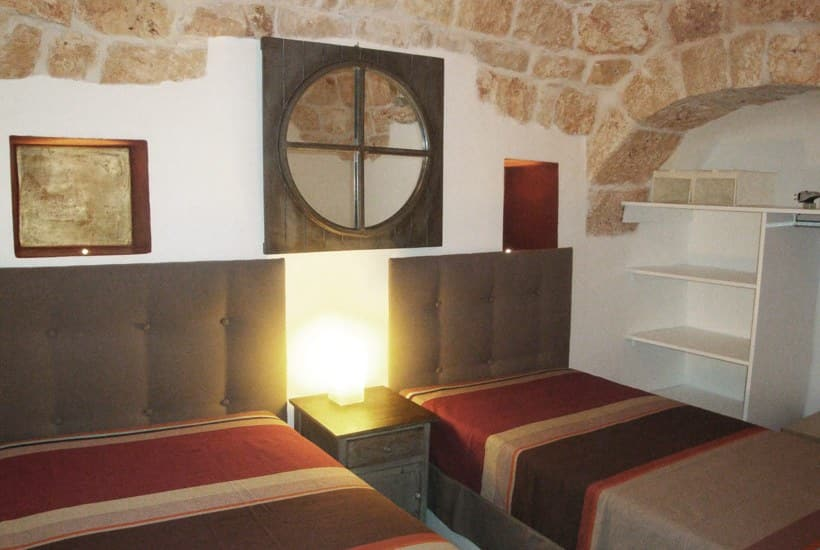 A bedroom in masseria Settarte in Cisternino