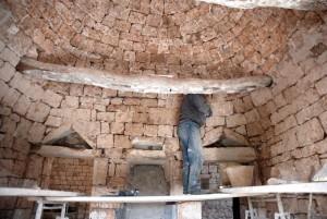 Man restoring the turnkey trullo property in Cistetrnino, Puglia