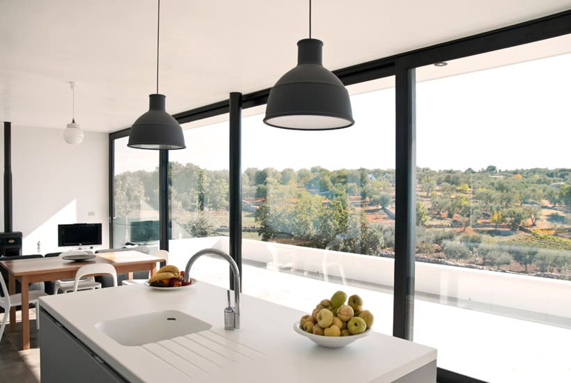 Interior design of a contemporary house in Puglia with view of the countryside
