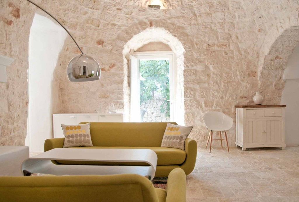 Living room in a restored trullo with swimming pool