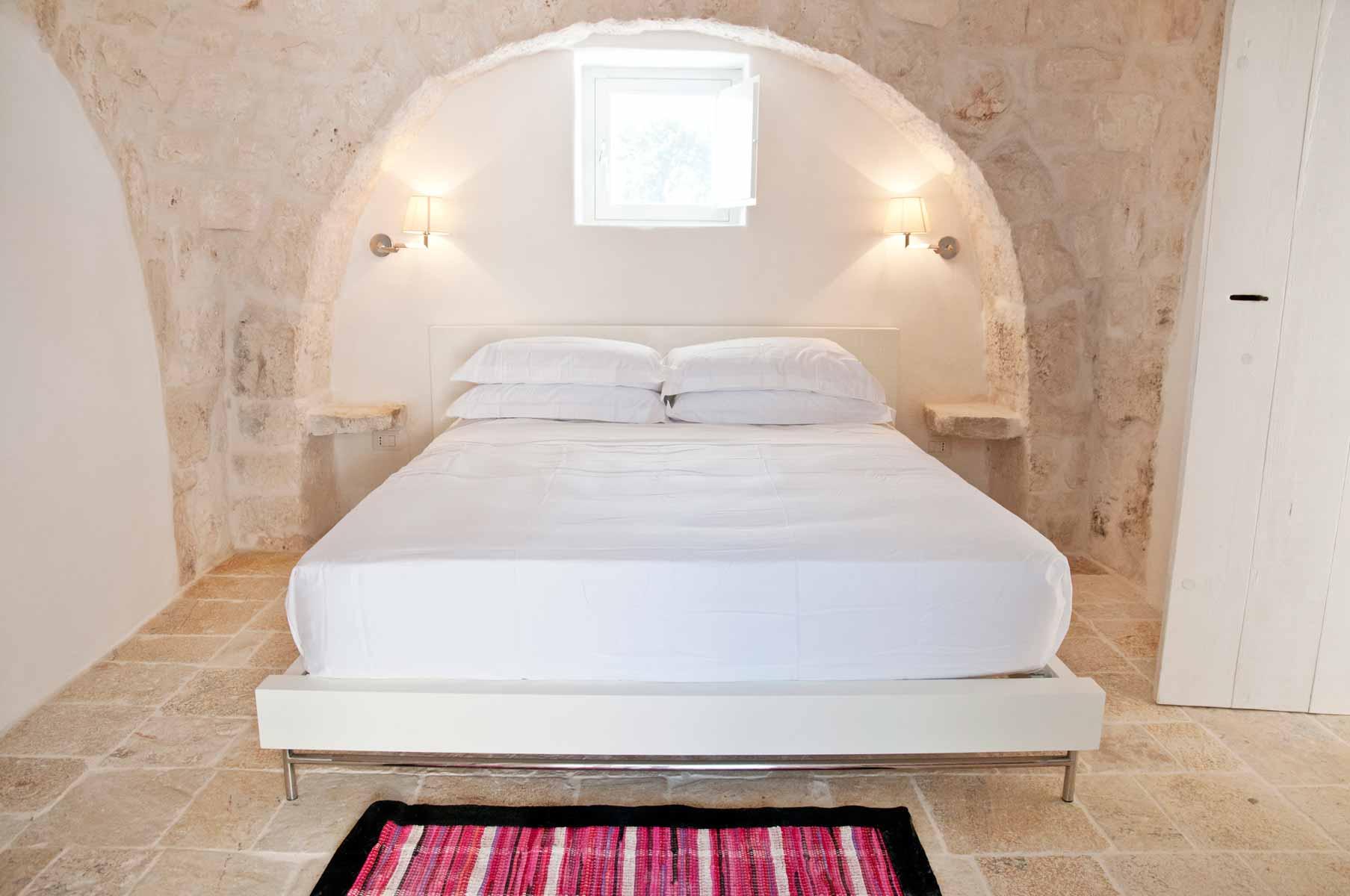 Bed in a trullo in Puglia
